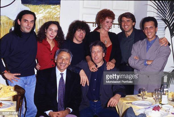 Music lyricist Mogol posing with the singersongwriters Mango Gianni Bella and Mario Lavezzi the singersongwriter and composer Riccardo Cocciante the...
