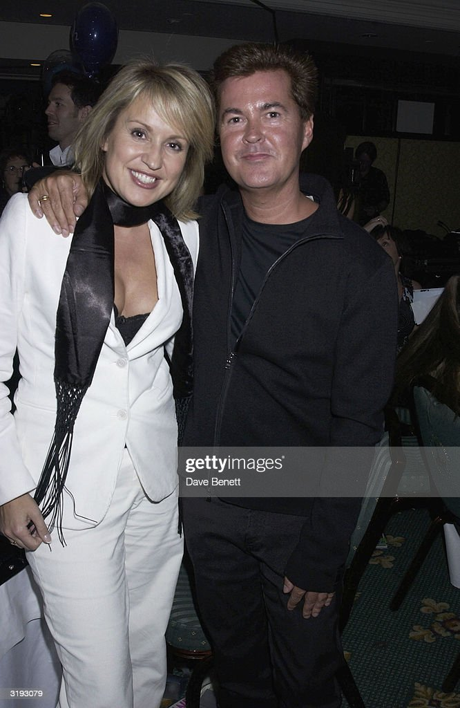 Music managers, Nicki Chapman and Simon Fuller attend the O2 Woman of The Year Awards, held at The Intercontinental Hotel on 29th November 2002, in London. (Photo by Dave Benett/Getty Images).