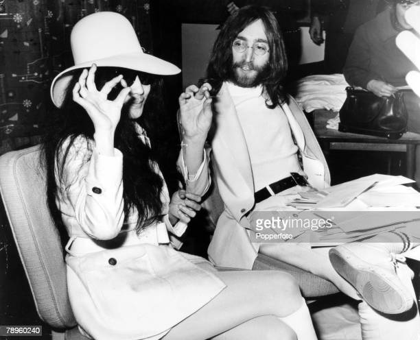 April 1969 London John Lennon and his wife Yoko Ono with envelopes and acorns as they promote a 'plant a seed for peace'