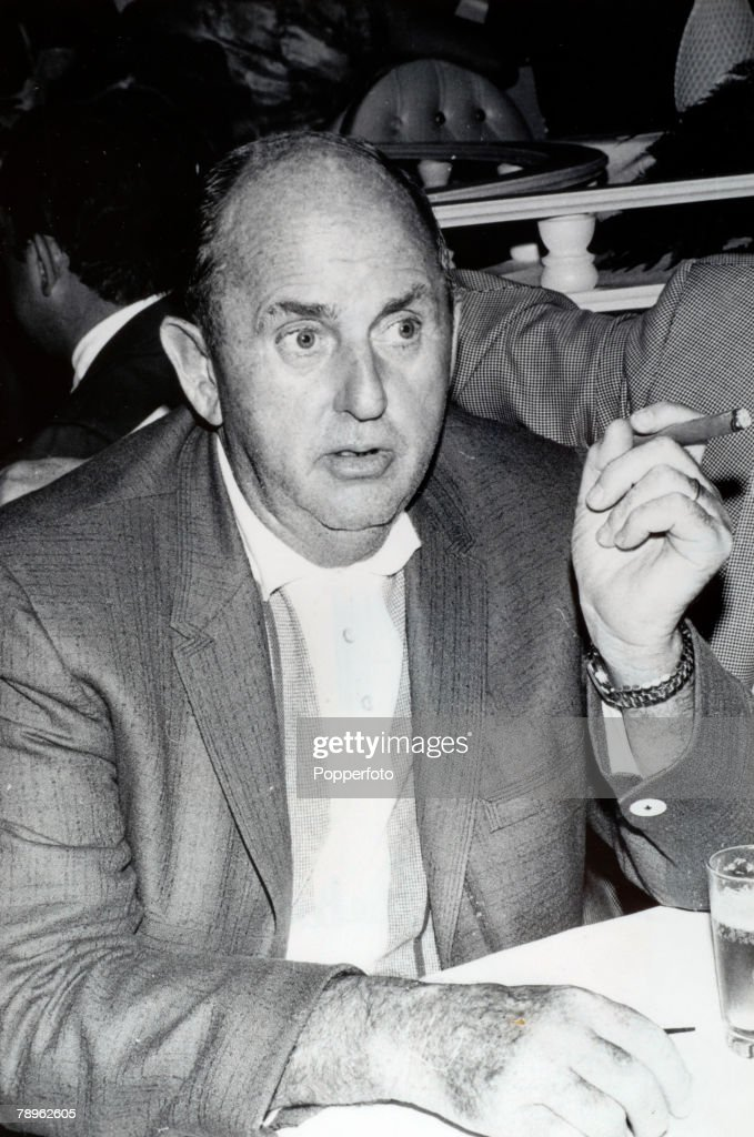 circa 1960's Elvis Presley's manager Col Tom Parker with his cigar In the 1950's Elvis Presley came to fame and was the first real rocknroll singer