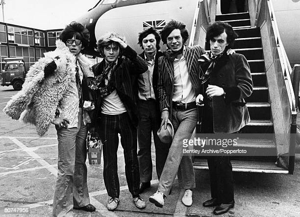 March 1967 The Rolling Stones group leaving London Airport leftright Keith Richards Brian Jones Charlie Watts Mick Jagger Bill Wyman