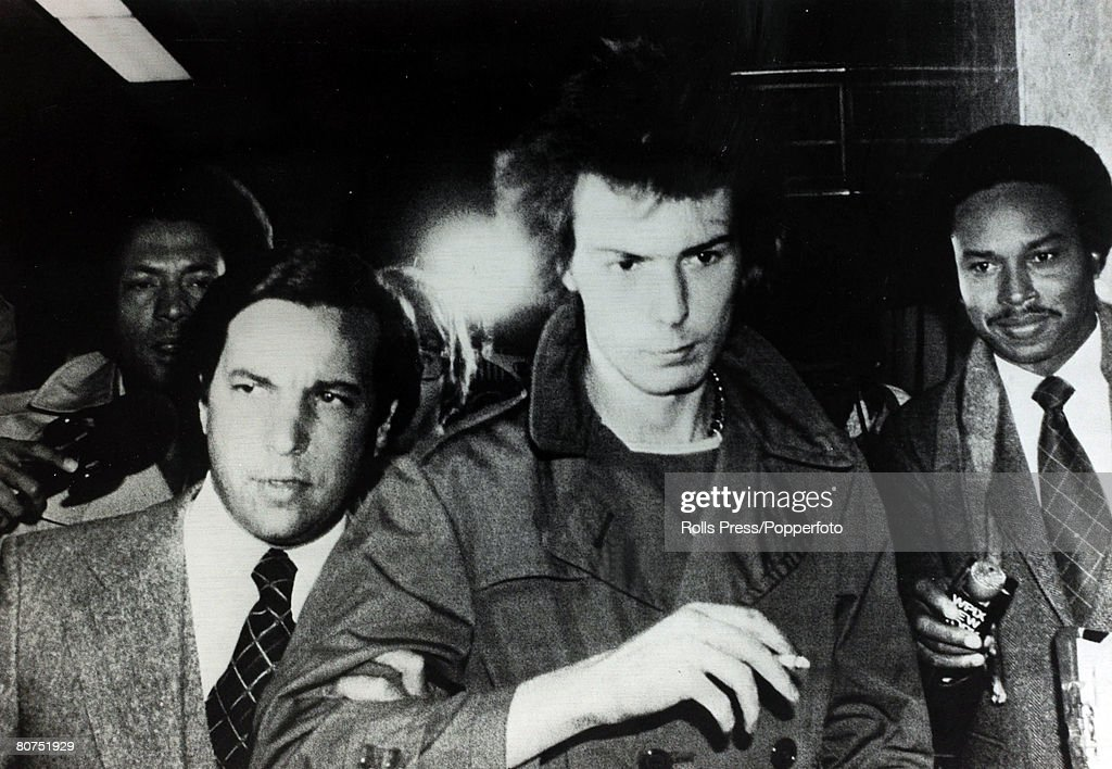 November 1978, British punk rock star Sid Vicious, centre, arrives at court in New York to face charges of having killed his American girlfriend Nancy Spungen by plunging a knife into her stomach