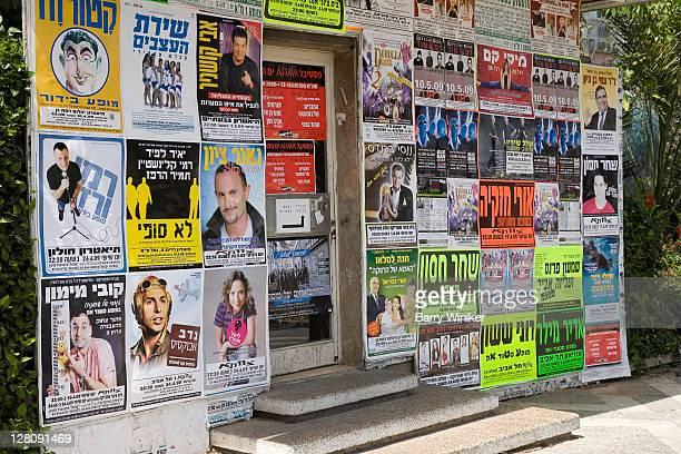 Music posters on building on street of Tel Aviv, Israel