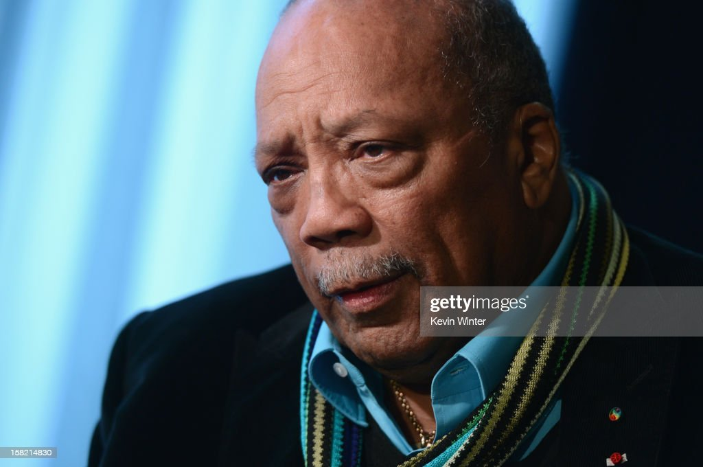 Music producer and Ahmet Ertegun Award recipient <a gi-track='captionPersonalityLinkClicked' href=/galleries/search?phrase=Quincy+Jones&family=editorial&specificpeople=171797 ng-click='$event.stopPropagation()'>Quincy Jones</a> is interviewed during the Rock and Roll Hall of Fame 2013 Inductees announcement at Nokia Theatre L.A. Live on December 11, 2012 in Los Angeles, California.