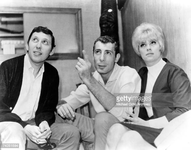 Music producer Brooks Arthur chats with songwriters and producers Jeff Barry and Ellie Greenwich in the studio circa 1965 in New York City New York
