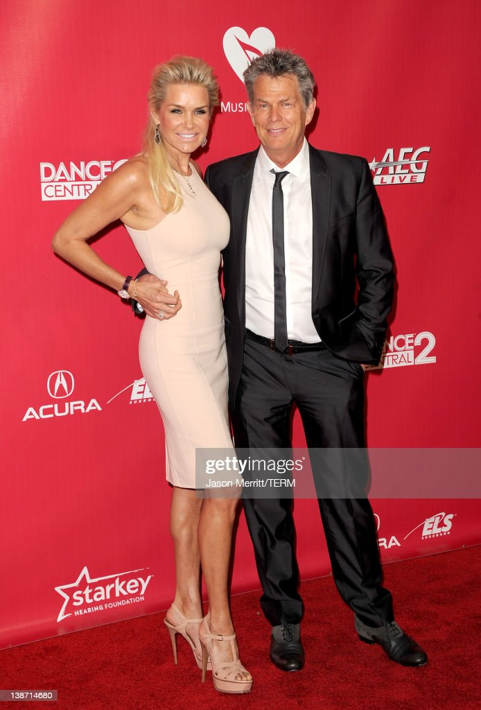 Music producer David Foster (R) and Yolanda Hadid arrive at the 2012 MusiCares Person of the Year Tribute To Paul McCartney held at the Los Angeles Convention Center on February 10, 2012 in Los Angeles, California.