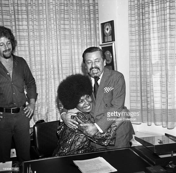 Music producer Joel Dorn singer Roberta Flack and Atlantic Records executive Nesuhi Ertegun during a luncheon to celebrate Roberta Flack signing to...