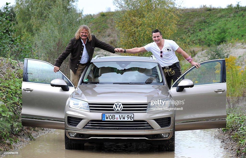 Music producer Leslie Mandoki and singer Andreas Gabalier (The Volks-Rock'n Roller) are testing the new VW Touareg on September 21, 2014 in Aschheim, Germany.