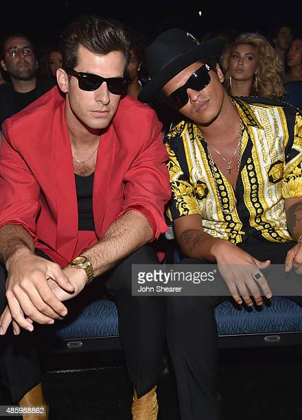 Music producer Mark Ronson and singersongwriter Bruno Mars in the audience during the 2015 MTV Video Music Awards at Microsoft Theater on August 30...