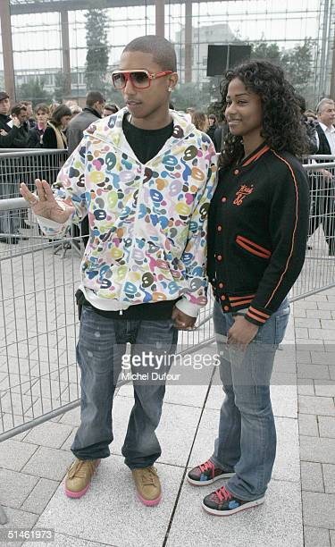 Music producer Pharrell Williams and guest arrive at the Louis Vuitton fashion show as part of Paris Fashion Week Spring/Summer 2005 on October 10...