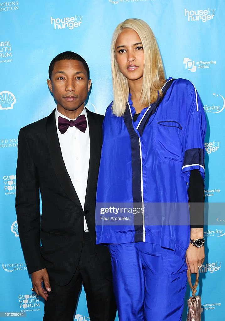 Music Producer Pharrell Williams (L) attends the 'mPowering Action' platform launch at The Conga Room at L.A. Live on February 8, 2013 in Los Angeles, California.