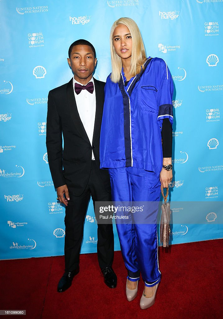 Music Producer <a gi-track='captionPersonalityLinkClicked' href=/galleries/search?phrase=Pharrell+Williams&family=editorial&specificpeople=161396 ng-click='$event.stopPropagation()'>Pharrell Williams</a> (L) attends the 'mPowering Action' platform launch at The Conga Room at L.A. Live on February 8, 2013 in Los Angeles, California.