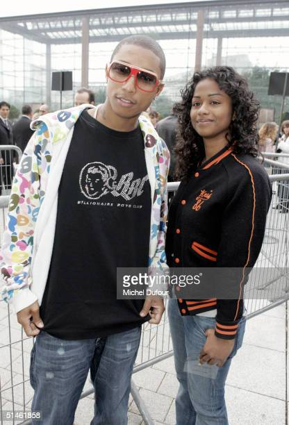 Music producer Pharrell Williams with guest arrive for the Louis Vuitton fashion show as part of Paris Fashion Week Spring/Summer 2005 on October 10...
