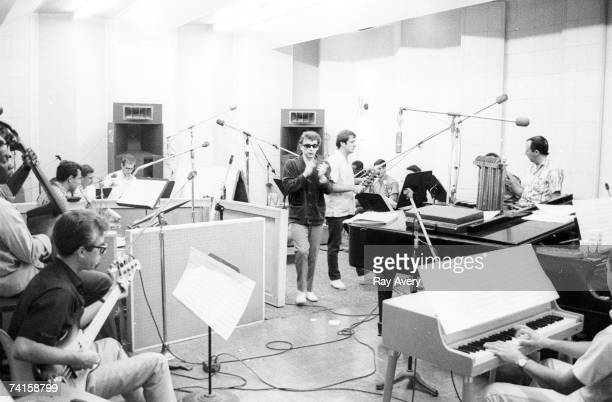 Music producer Phil Spector with his session musicians dubbed the 'Wrecking Crew' creating his trademark 'Wall of Sound' in 1965 at Gold Star Studios...