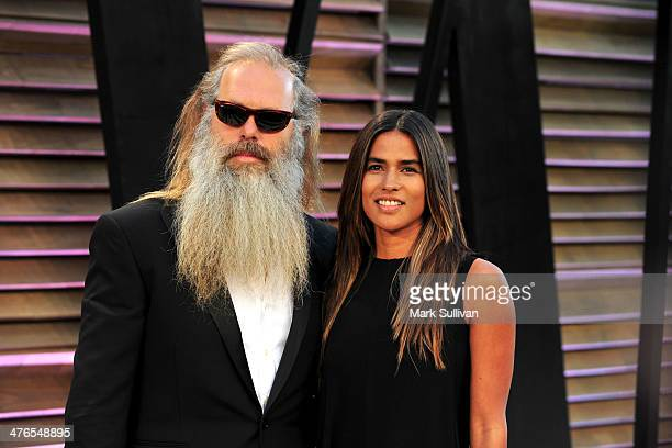 Music producer Rick Rubin and actress/producer Mourielle Herrera attend the 2014 Vanity Fair Oscar Party hosted by Graydon Carter on March 2 2014 in...