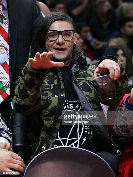 Music Producer Skrillex attends the NBA game between the Golden State Warriors and the Los Angeles Clippers at Staples Center on December 25 2014 in...