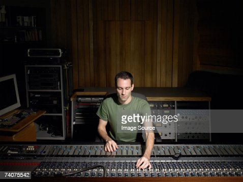 Music producer using mixing desk