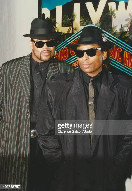 Music producers Jimmy Jam and Terry Lewis wearing tophat and sunglasses posing during the 1988 ACE awards for cable television Los Angeles California...