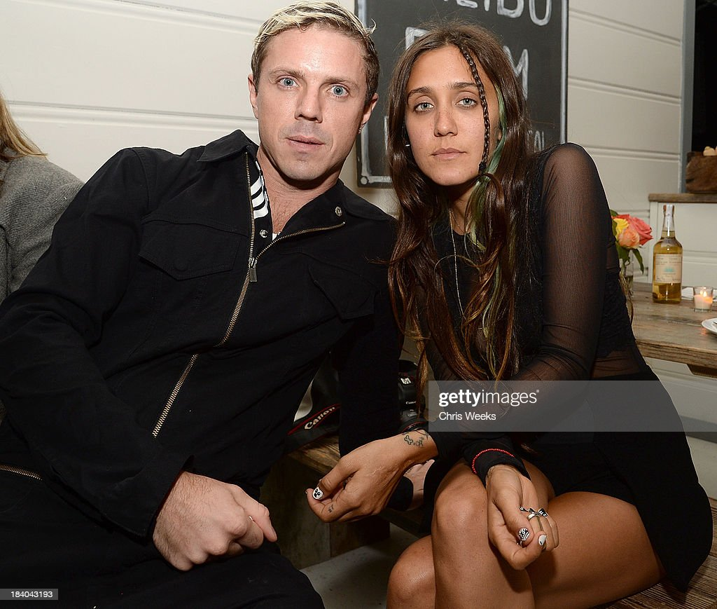 Music recording artist Jake Shears and Jesse Jo Stark attend a dinner for Gareth Pugh hosted by Chrome Hearts at Malibu Farm on October 10, 2013 in Malibu, California.
