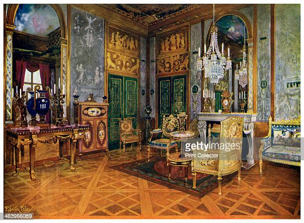 Music room of Marie Antoinette Palais de Fontainebleau France 19111912 Carved gilt console gilt settee in Beauvais tapestry table with ormolu mounts...