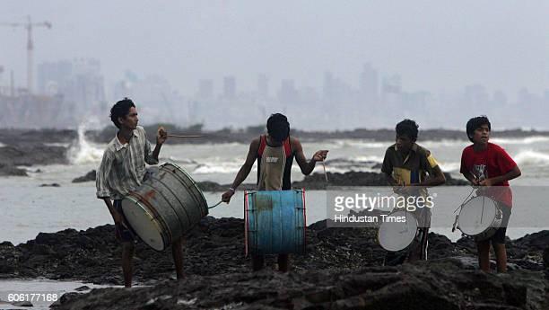 Music Siddhesh Sagar Hemant and Nikhil members of a 'Nasik Dhol' band practise near the beachfront for Durga Idol immersion tomorrow