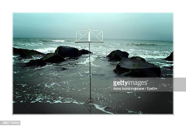 Music Stand On Beach Against Sky