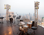 music stands and drums at stage of a high building