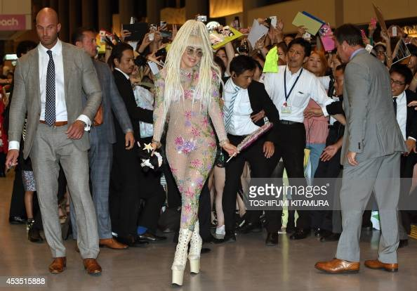 US music star Lady Gaga greets fans upon her arrival at the Narita International airport in Narita Chiba prefecture on August 12 2014 Gaga is set to...