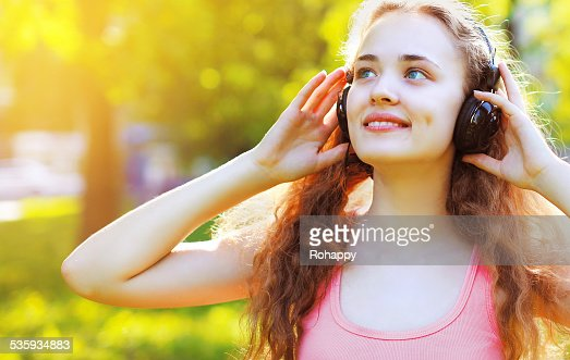 Music, summer, leisure and people concept - lifestyle portrait p : Stock Photo