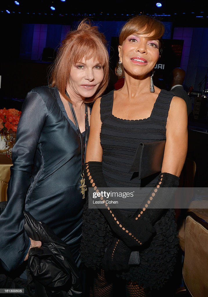 Music supervisor Kathy Nelson (L) and music executive Sylvia Rhone attend the 55th Annual GRAMMY Awards Pre-GRAMMY Gala and Salute to Industry Icons honoring L.A. Reid held at The Beverly Hilton on February 9, 2013 in Los Angeles, California.