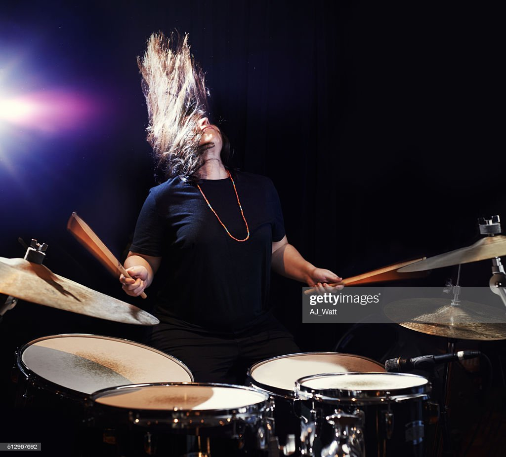 Music to bang her head to! : Stock Photo