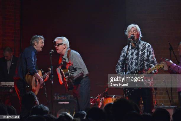 Music writer Mark Ellen and singersongwriter Nick Lowe perform with Robyn Hitchcock at A 60th Birthday Tribute To Robyn Hitchcock at Village...