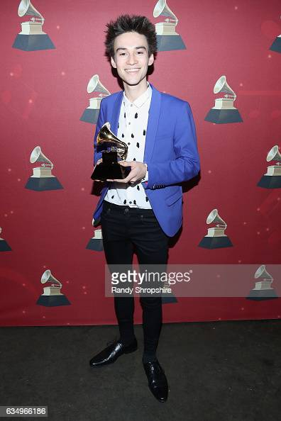 Musical arranger Jacob Collier poses with the Best Arrangement Instrumental or A Cappella award for 'In My Room' backstage at the Premiere Ceremony...