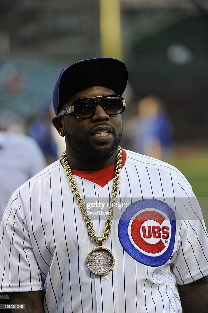 Musical artist Big Boi from the group Outkast throws out the first pitch before the game between the Chicago Cubs and the San Diego Padres on May 1, 2013 at Wrigley Field in Chicago, Illinois.