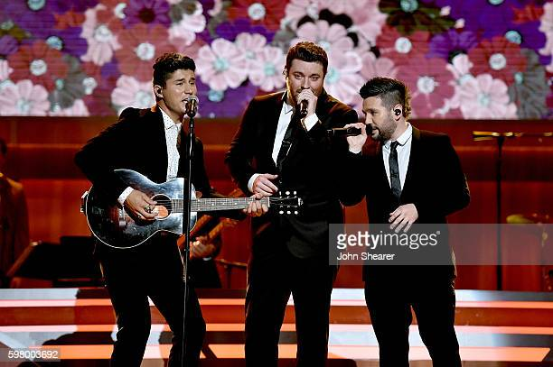 Musical artists Dan Smyers from musical group Dan Shay Chris Young and Shay Mooney from musicial group Dan Shay perform onstage during the 10th...