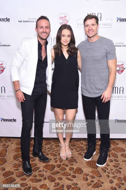 Musical artists Drew Baldridge Bailey Bryan and Walker Hayes pose backstage at the Innovation In Music Awards on June 6 2017 in Nashville Tennessee