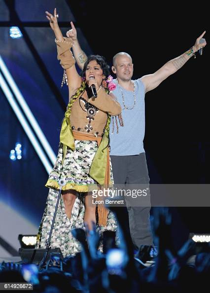 Musical artists Lila Downs and Rene 'Residente' Perez perform onstage at Univision and Fusion host RiseUp AS ONE at Cross Border Xpress on October 15...