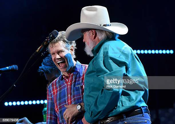 Musical artists Randy Travis and Charlie Daniels onstage during 2016 CMA Festival Day 1 at Nissan Stadium on June 9 2016 in Nashville Tennessee