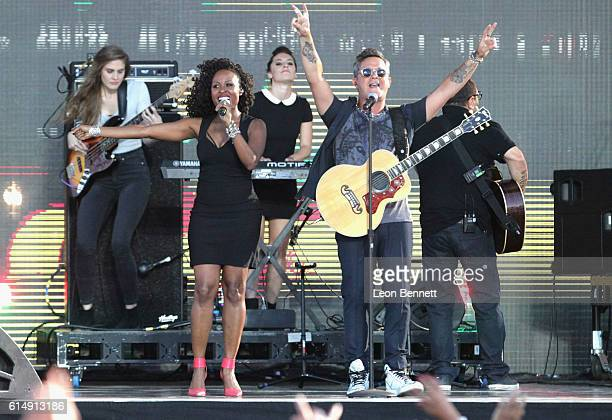Musical artists Sara Divine and Alejandro Sanz perform onstage at Univision and Fusion host RiseUp AS ONE at Cross Border Xpress on October 15 2016...