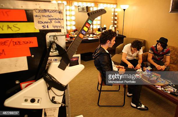 Musical band Jonas Brothers during a photo shoot about the concert and backstage of their The Burning Up Tour date on August 14th 2008 at Bethel...