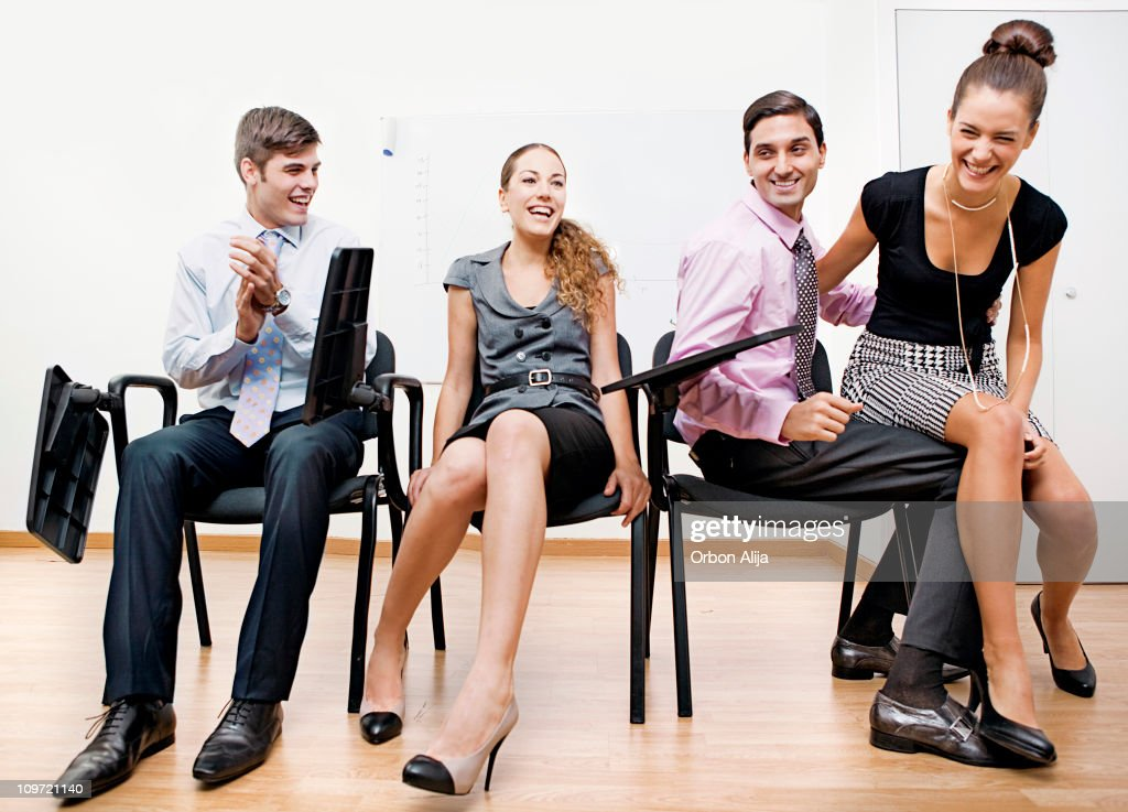 Musical chairs game at the office stock photo getty images for Chaise musicale