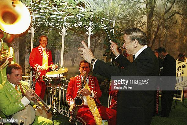 Musical composer Richard Sherman conducts the band at the afterparty for Disney's 'Mary Poppins' 40th Anniversary Edition DVD Launch party and...