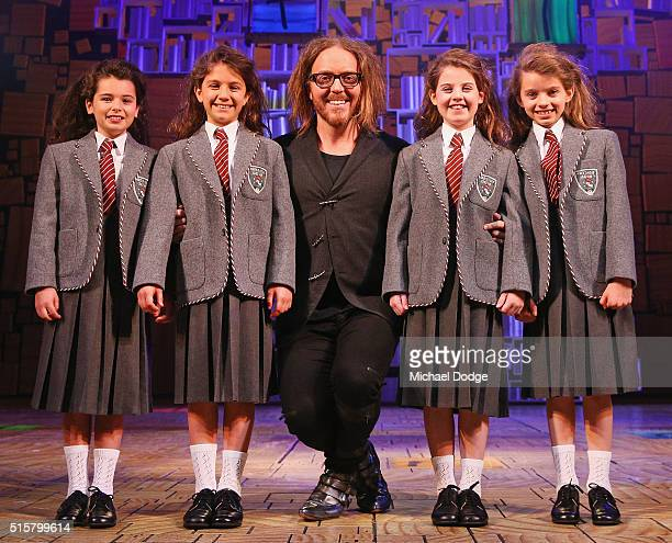 Musical director Tim Minchin poses with the four Matilda cast members Dusty Bursill Tiana Mirra Alannah Parfett and Ingrid Torelli perform during a...