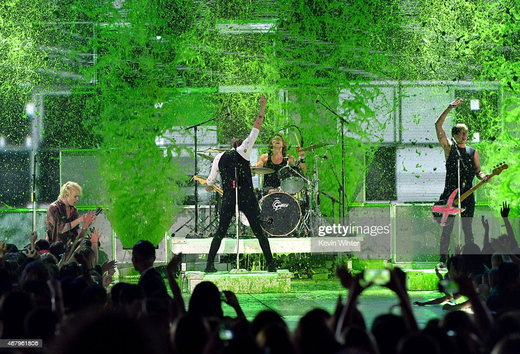 Musical group 5 Seconds of Summer gets slimed while performing onstage during Nickelodeon's 28th Annual Kids' Choice Awards held at The Forum on...