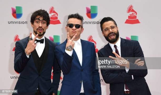 Musical group Diamante Electrico arrives for the 18th Annual Latin Grammy Awards in Las Vegas Nevada on November 16 2017 / AFP PHOTO / Mark RALSTON