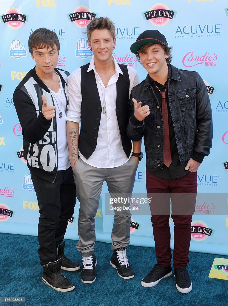 Musical group Emblem3 arrives at the 2013 Teen Choice Awards at Gibson Amphitheatre on August 11, 2013 in Universal City, California.