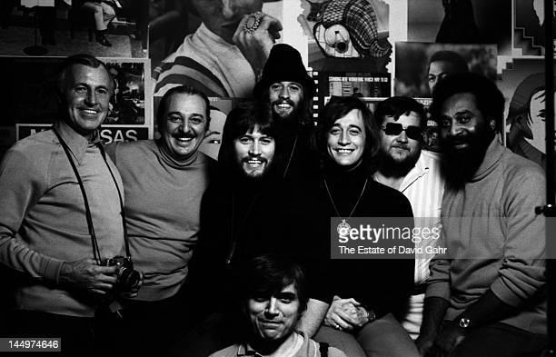 Musical group The Bee Gees family and studio personnel pose for a portrait in April 1974 in the offices of RSO Records in Miami Florida