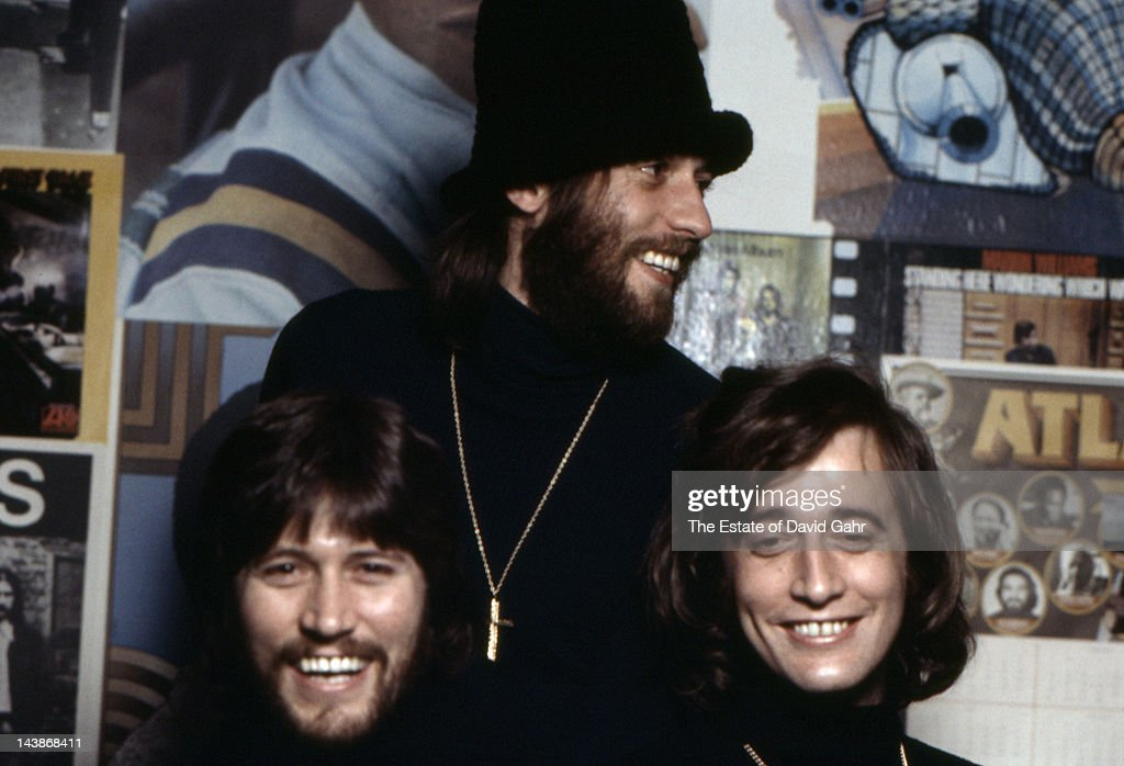 Musical group The Bee Gees (L-R <a gi-track='captionPersonalityLinkClicked' href=/galleries/search?phrase=Barry+Gibb&family=editorial&specificpeople=208122 ng-click='$event.stopPropagation()'>Barry Gibb</a>, <a gi-track='captionPersonalityLinkClicked' href=/galleries/search?phrase=Maurice+Gibb&family=editorial&specificpeople=214760 ng-click='$event.stopPropagation()'>Maurice Gibb</a>, <a gi-track='captionPersonalityLinkClicked' href=/galleries/search?phrase=Robin+Gibb&family=editorial&specificpeople=211371 ng-click='$event.stopPropagation()'>Robin Gibb</a>) pose for a portrait in April 1974 in Miami, Florida.