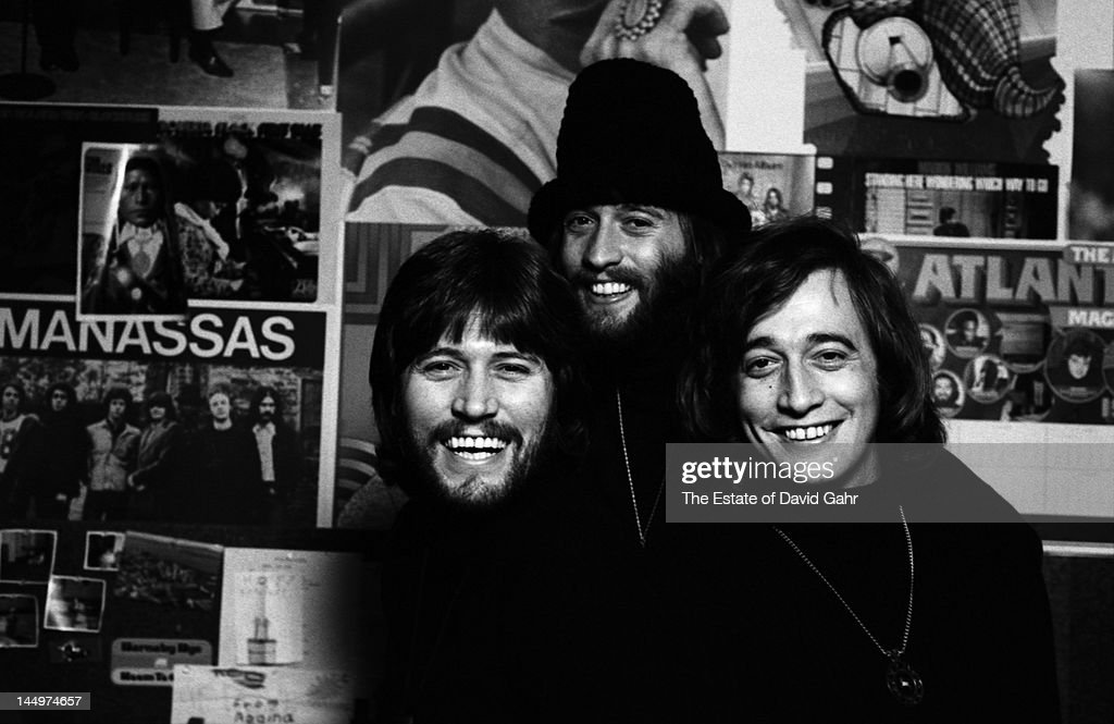 Musical group The Bee Gees (L - R <a gi-track='captionPersonalityLinkClicked' href=/galleries/search?phrase=Barry+Gibb&family=editorial&specificpeople=208122 ng-click='$event.stopPropagation()'>Barry Gibb</a>, <a gi-track='captionPersonalityLinkClicked' href=/galleries/search?phrase=Maurice+Gibb&family=editorial&specificpeople=214760 ng-click='$event.stopPropagation()'>Maurice Gibb</a>, <a gi-track='captionPersonalityLinkClicked' href=/galleries/search?phrase=Robin+Gibb&family=editorial&specificpeople=211371 ng-click='$event.stopPropagation()'>Robin Gibb</a>) pose for a portrait in April 1974 in Miami, Florida.