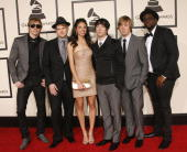Musical group The Plain White T's with Delilah arrive on the red carpet for The 50th Annual Grammy Awards held at the Staples Center on February 10...